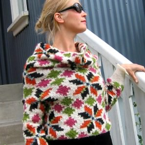 Le tricot jacquard islandais: modèle rose à huit pétales